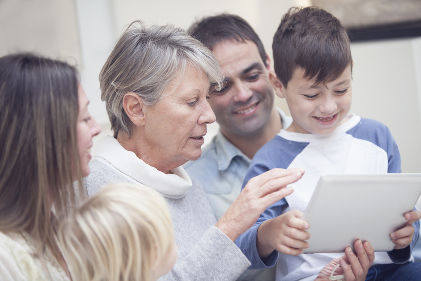 Happy Family Playing With Tablet
